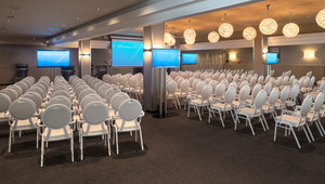 Event room in theater setup with extra TV screens