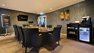 Boardroom for 10 guests with TV screen flip chart and drink facilities