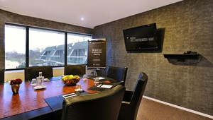 Boardroom with plasma screen and flipchart